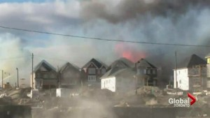Investigators looking into cause of massive Mount Albert fire
