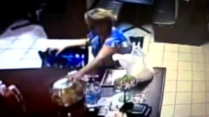 Woman caught on camera taking donation jar police in Florida say belonged to family of shooting victim