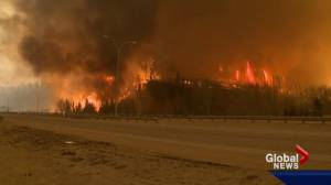 Fort McMurray wildfire: 53,000 people forced to flee as fire enters community (03:21)
