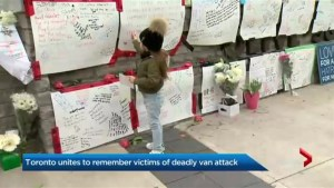Mourners leave messages, flowers at memorial near site of deadly van attack