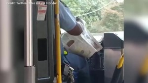 Bus driver reading newspaper while driving caught on camera