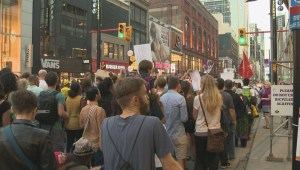 Protest and rally at Yonge-Dundas Square demanding change to the refugee process