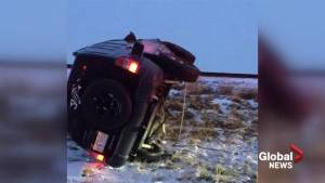 Good Samaritans help woman in flipped SUV