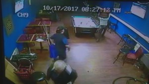 Surveillance video of patrons taking down shotgun wielding suspect