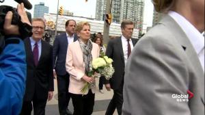 Toronto van attack: Kathleen Wynne, John Tory visit memorial site
