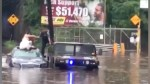 Police in New Jersey help bride off car as flooding waters strand vehicle