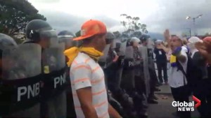 Protesters in Venezuela hurl objects, chant slogans at police officers during anti-Maduro protests