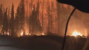 Night and day images of the Shovel Lake fire as it passes through one B.C. community