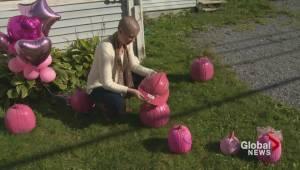Saint John woman surprised with pink pumpkins