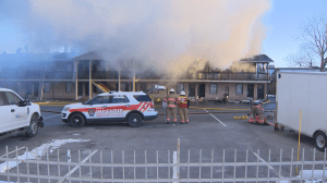Fire engulfs the Econo Lodge on Brossard's Taschereau Boulevard