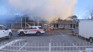 Fire engulfs the Econo Lodge on Brossard's Taschereau Boulevard