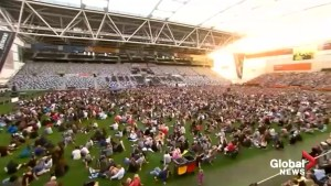 New Zealand shooting: Thousands pack Dunedin stadium in vigil for the fallen