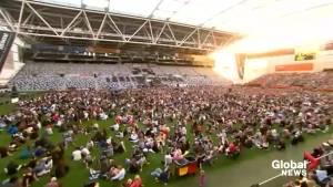 New Zealand shooting: Thousands pack Dunedin stadium in vigil for the fallen