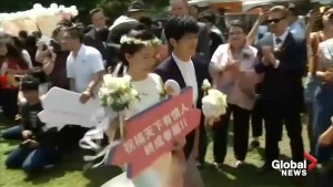Taiwan celebrates Asia's first same-sex marriages as couples tie the knot