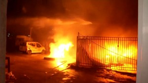 Emergency crews put out flames after rockets fire into Israel during botched raid