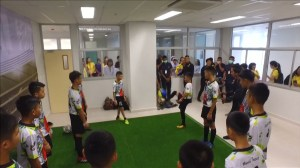 Thai boys and coach play soccer after discharge from hospital
