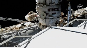 Russia cosmonauts take spacewalk to inspect repair done to Soyuz rocket