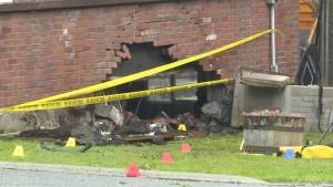 A speeding pickup truck slams into a home, leaving a gaping hole in the basement wall