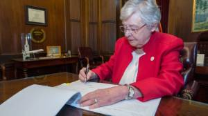 Alabama governor signs abortion bill into law