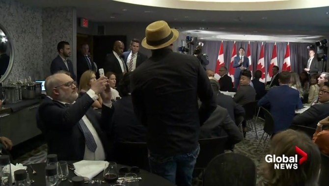 'No right to do that to us': Indigenous protester interrupts Trudeau speech in Vancouver
