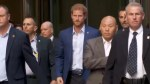 Prince Harry exits Toronto skyscraper to cheers from crowd