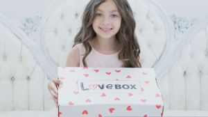 8-year old spreading the message of hope in boxes filled with love