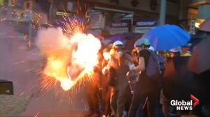Hundreds of riot police block protesters, throw tear gas in Hong Kong's retail area