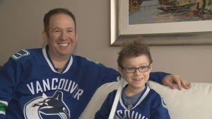 B.C. dad and son tell the story of 'Hogdog Horvat' sign spotted at Canucks game