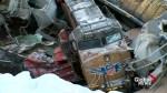 Train cars lay beside highway after fatal train derailment