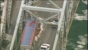 Dump truck with raised bucket slams into Montreal bridge snarling traffic