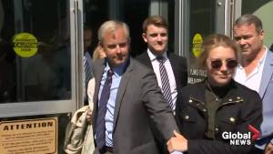 Dennis Oland leaves court after being found not guilty in father's murder