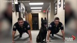 Alabama police dog does pushups with officers