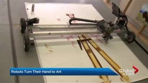 Artist uses custom-made robots to paint