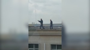 Armed police recorded climbing across Brussels buildings following attack