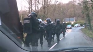 Heavily armed police move in to area where Paris shooting suspects are thought to be