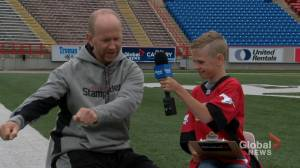 Junior Reporter Nixon interviews Stampeders head coach Dave Dickenson