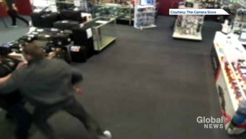 Robbery at the camera store caught on tape watch news videos online - Div height 100 percent of parent ...