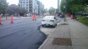 Montreal worker paves around car on René Lévesque Boulevard