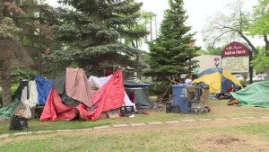 Tent city at West Broadway Church coming down