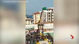 Soccer fan banned from stadium rents crane to watch game in Turkey