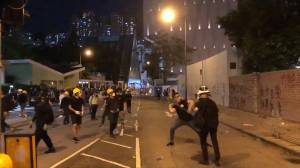 Hong Kong protesters throw projectiles, smash windows during citywide strike