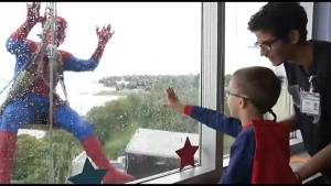 Window washers dress as superheroes to surprise kids at a Kingston hospital