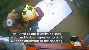 US Coast Guard rescues child trapped on roof by flooding in Louisiana