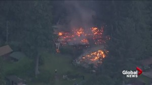 Raw:  House fire burns in remote community near Deep Cove