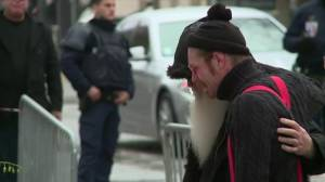 Tears as Eagles of Death Metal visit Paris memorial site outside Bataclan Café