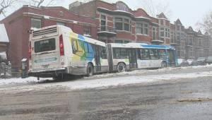Buses, cars sliding during Montreal snowfall