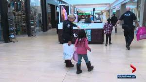 Edmonton police officers take kids on a shopping spree
