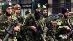 Canadian soldiers march with weapons at Toronto Khalsa Day Parade