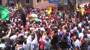 Thousands attend funeral for Palestinian paramedic, 21, shot dead in Gaza (00:47)