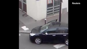 New video of Charlie Hebdo attack shows police backing away from gunmen